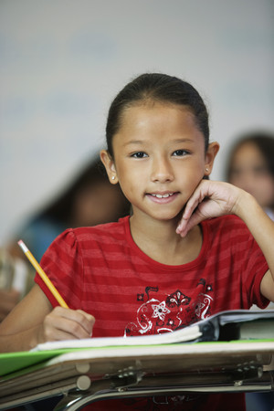 girl in full growth: Asian girl at desk in classroom