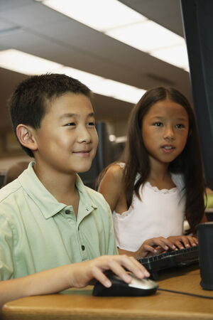 low spirited: Asian students using school computer