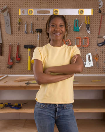 woodcutting: African American woman in woodworking shop