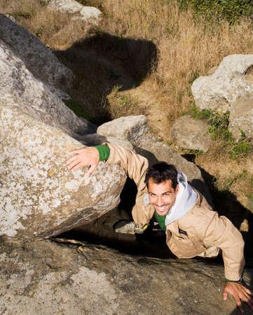 islander: Pacific Islander man climbing rock formation