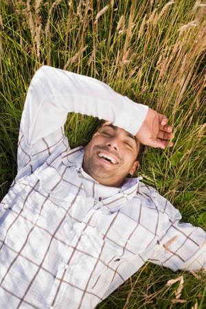 islander: Pacific Islander man laying in field