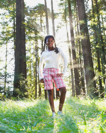 African girl standing in woods