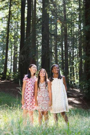 adventuresome: Multi-ethnic girls standing in woods