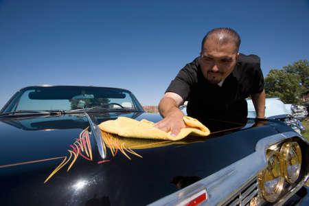 buffing: Hispanic man buffing show car LANG_EVOIMAGES