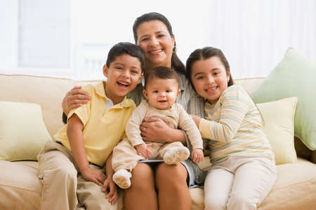 mothers group: Hispanic mother and children on sofa
