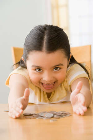 gramma: Hispanic girl with pile of coins