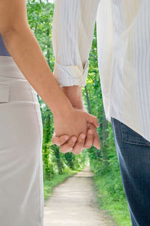 mischeif: African American couple holding hands LANG_EVOIMAGES