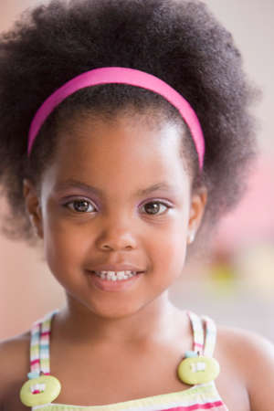 eagerness: Close up of African American girl wearing headband