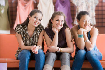 teenaged girls: Multi-ethnic teenaged girls at clothing store