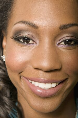 devilment: Close up of African woman smiling LANG_EVOIMAGES