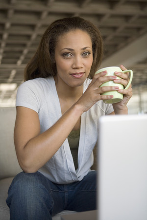 acknowledging: African American woman holding coffee mug