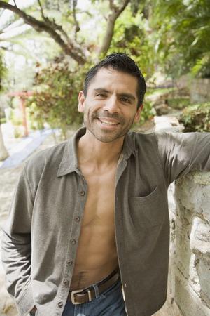interrogating: Hispanic man with shirt open LANG_EVOIMAGES