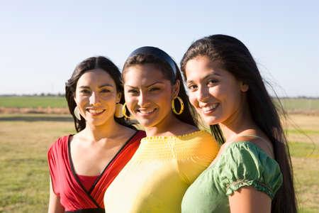 daydreamer: Row of multi-ethnic women in sunlight LANG_EVOIMAGES