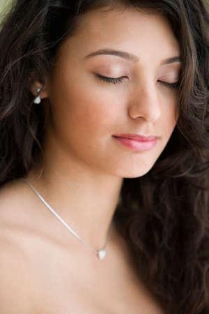 teenaged girl: Hispanic teenaged girl with eyes closed