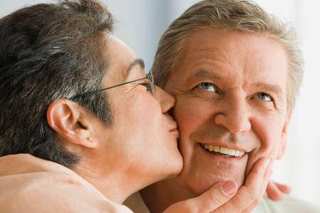 gramma: Woman kissing husband's cheek LANG_EVOIMAGES