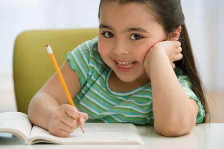 80 plus adult: Hispanic girl doing homework