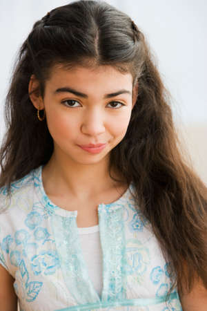 teenaged girl: Portrait of Hispanic teenaged girl LANG_EVOIMAGES