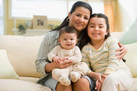 grampa: Hispanic grandmother and grandchildren on sofa