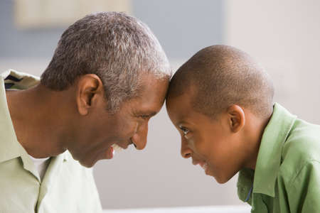 grampa: African American grandfather and grandson touching foreheads LANG_EVOIMAGES