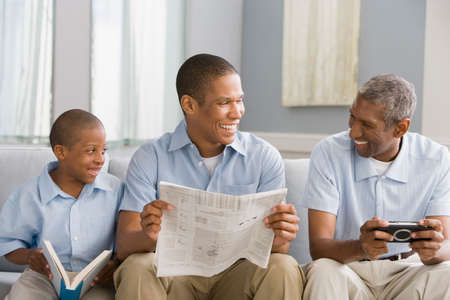playing on divan: African American grandfather, father and son relaxing LANG_EVOIMAGES