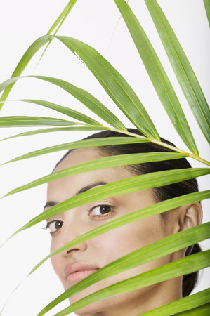 palm frond: Indian woman behind palm frond