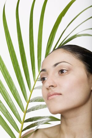 frond: Indian woman next to palm frond