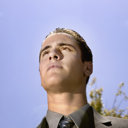 Low angle view of Hispanic businessman