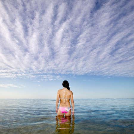 nite: Pacific Islander woman standing in ocean LANG_EVOIMAGES