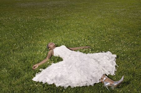relishing: African woman laying in grass