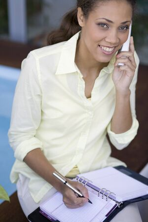 telecommuter: African American woman talking on telephone LANG_EVOIMAGES