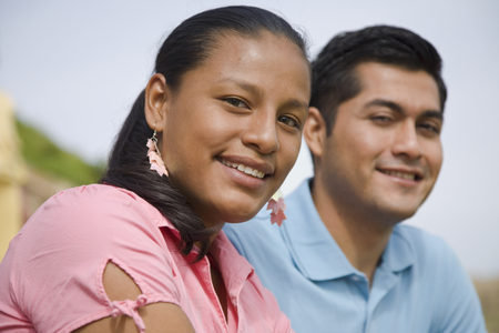adventuresome: Close up of Hispanic couple smiling LANG_EVOIMAGES