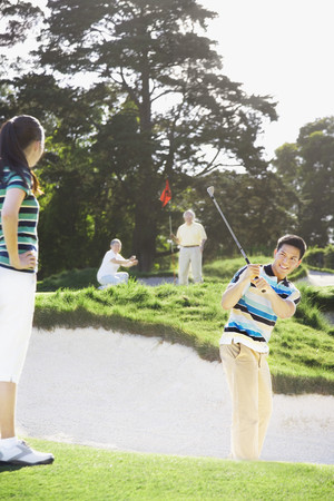 shrieking: Asian couple playing golf