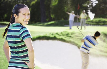shrieking: Asian woman on golf course