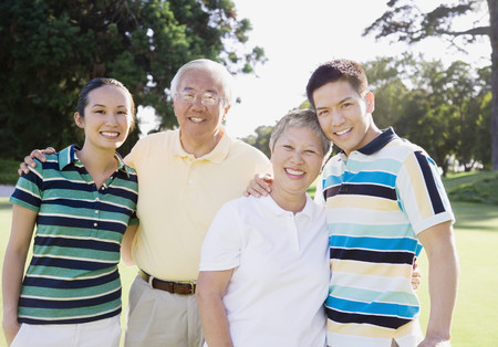 Asian family hugging
