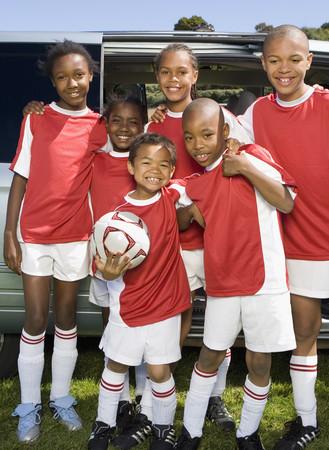 late 60s: Multi-ethnic children in soccer uniforms LANG_EVOIMAGES