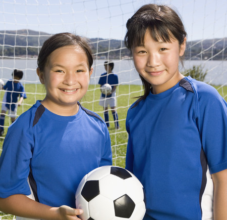 gusto: Multi-ethnic girls with soccer ball LANG_EVOIMAGES