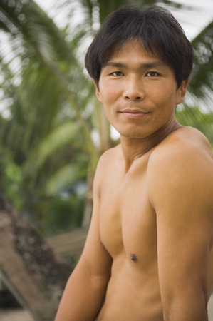 barechested: Close up of bare-chested Asian man