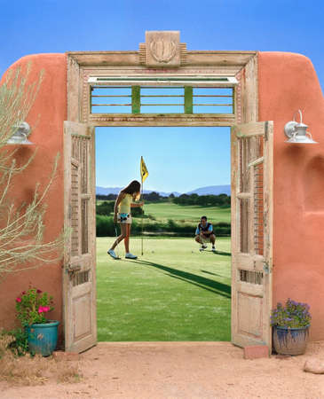 view through: View through doorway to couple playing golf