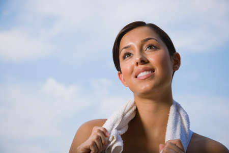 wearying: Hispanic woman with towel around neck LANG_EVOIMAGES