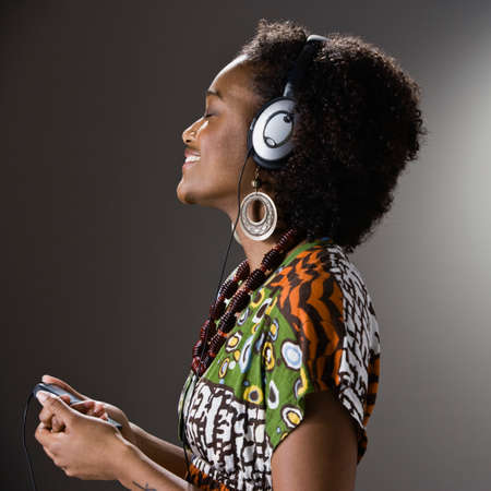 1 woman only: African American woman listening to headphones LANG_EVOIMAGES