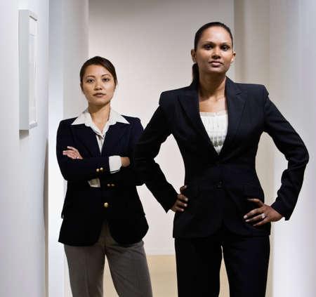 stepping: Multi-ethnic businesswoman in hallway