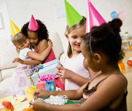 Multi-ethnic girls at birthday party LANG_EVOIMAGES