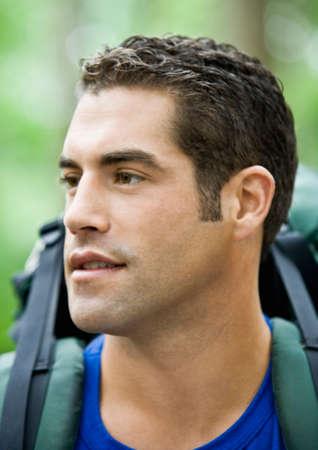 devilment: Hispanic man wearing backpack