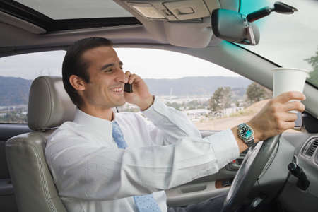 talker: Hispanic businessman talking on cell phone