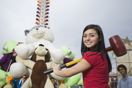 prevailing: Mixed Race teenaged girl playing carnival game
