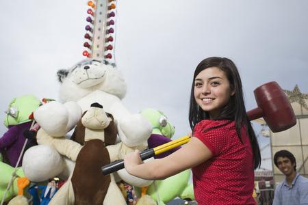 teenaged girl: Mixed Race teenaged girl playing carnival game