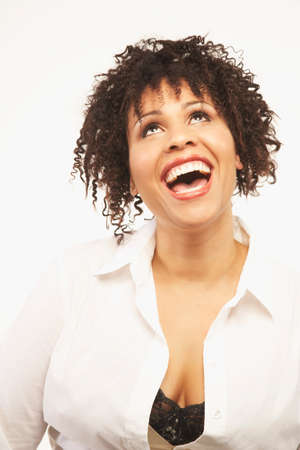 dollarbill: Mixed Race woman laughing LANG_EVOIMAGES