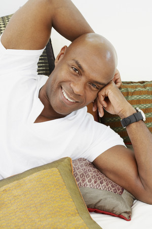 davenport: African American man laying on pillows LANG_EVOIMAGES