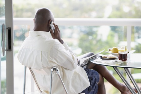pakistani ethnicity: African American man talking on telephone
