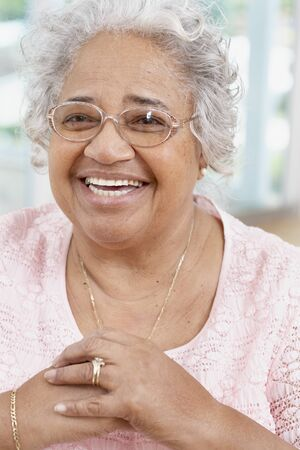 1 woman only: Senior African American woman wearing eyeglasses LANG_EVOIMAGES